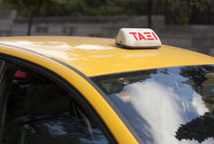 Taxi in Athens. Taxi sign on yellow taxi in Athens, Greece royalty free stock images