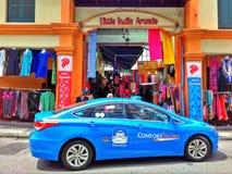 Taxi azul, Singapur Imagenes de archivo