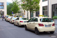 Taxi Berlin. BERLIN - MAY 23, 2014: A row of taxi's in a street in Berlin. The taxi business is heavily regulated in Germany. Most of cities have typical cream Royalty Free Stock Photography