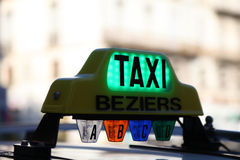 Taxi in Beziers, France. Taxi sign in Beziers, southern France Stock Image