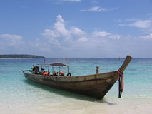 Taxi Boat. A beached taxi boat in Koh Pi Pi, an island in southern Thailand Stock Photos