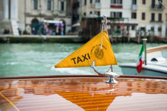 Taxi boat on Canal Grande with Venezia Royalty Free Stock Image