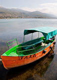 Taxi boat in Ohrid Macedonia. An orange motorboat in the lake of Ohrid with a taxi sign royalty free stock image