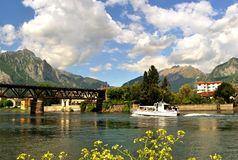 Taxi boat is taking its passengers for a trip at lake Como district. Royalty Free Stock Photography