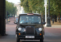 Taxi in Buckingham Palace Road. A London taxi along Buckingham Palace Road royalty free stock photography