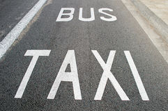 Taxi and bus lane. Close up of taxi and bus lane Stock Images