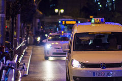 Taxi and bus on public transport lane in Madrid, at night Royalty Free Stock Photo