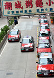 Taxi business in Hongkong. View of Hongkong traffic, taxi in line as waiting for business at a small street, shown as city featured transportation management Stock Photos