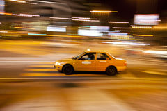 Taxi in busy city Royalty Free Stock Photos
