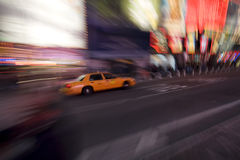 Taxi Cab. A yellow taxi cab driving down a road Royalty Free Stock Photos