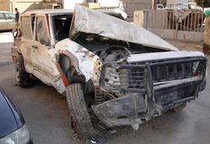 Taxi cab blasted by a car bomb. Armored SUV disguised as aTaxi cab in Baghdad Iraq which was blasted by a close by exploding car bomb Stock Photography