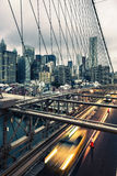 Taxi cab crossing the Brooklyn Bridge Stock Photo