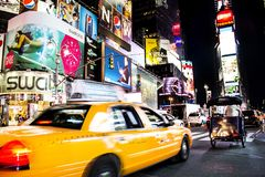 Times Square, New York City, New York, United States - circa 2012 taxi cab driving in times square night motion blurry Royalty Free Stock Images