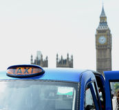 Taxi cab in front of Big Ben Royalty Free Stock Photography