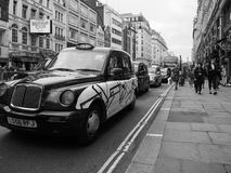 Taxi cab in London black and white. LONDON, UK - CIRCA JUNE 2017: Taxi cabs in the city centre in black and white royalty free stock photos