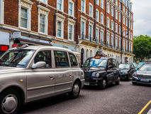 Taxi cab in London (hdr) Stock Photography