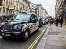 Taxi cab in London (hdr) Stock Photos