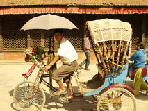 Taxi cab in Nepal. Smiling, happy taxi bike driver in Nepal Kathmandu Royalty Free Stock Photo