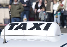 Taxi cab sign. In city centre Stock Photo