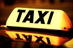 Taxi cab sign. Close up on a yellow taxi cab sign Stock Photo
