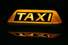 Taxi cab sign. Close up on a yellow taxi cab sign Stock Image