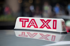 Taxi cab sign on roof of a taxi Stock Image