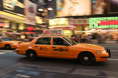 Taxi cab speeding through city Royalty Free Stock Image
