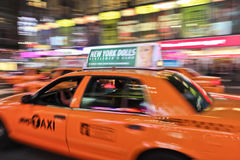 Taxi cab speeding through city Stock Photo