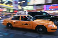 Taxi cab speeding through city Royalty Free Stock Images