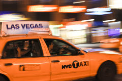 Taxi cab speeding through city Stock Photography