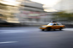 Taxi cab speeding down street in a blur Stock Image