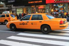 Taxi cab at Times Square. Taxi on a busy street in Times Square stock image