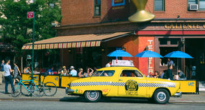 Taxi cab, West Village, New York City. Taxi cab curbside in West Village neighborhood of New York City on sunny day Royalty Free Stock Photography