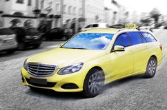 Taxi cab. Yellow taxi cab on the street. Black and white background stock photography