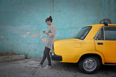 Taxi cab. A young girl is waiting next to a taxi cab royalty free stock images