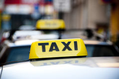 Taxi cabs. Signs on top of cars Stock Photography