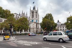 Taxi cabs go on the street in London city. London, United Kingdom - October 29, 2017: Taxi cabs go on the street in London city Royalty Free Stock Photos
