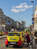 Taxi cabs waiting for customers downtown Bucharest Royalty Free Stock Photo