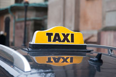 Taxi cap on a car roof Stock Photo