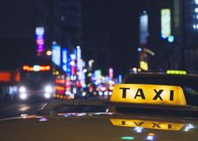 Taxi Cap sign Taxi stand service Nightlife in city royalty free stock images