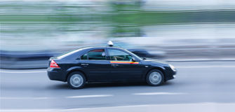 Taxi car blur motion. Royalty Free Stock Photography