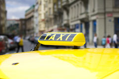 Taxi car in the city street Royalty Free Stock Photo