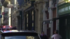 Taxi car driving down the street in old European city, transportation services. Stock footage stock video