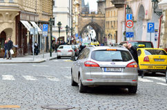 Taxi car in old district of Prague city Royalty Free Stock Images
