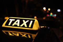 Taxi car sign. In the night Stock Photos