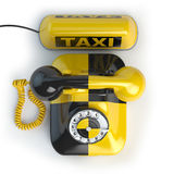 Taxi car sign and yellow telephone on white isolated background. Royalty Free Stock Photos