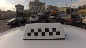 The taxi car is on street of Moscow. SEP 03, 2017, MOSCOW, RUSSIA: The taxi car is on street of Moscow. Taxi checkers. Shot of top light box or checkers on taxi stock video