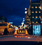 Taxi car on the street at night Stock Photo