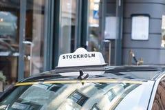 The taxi car on the street Royalty Free Stock Photos