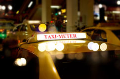 Taxi car waiting customer on the street at night Stock Image
